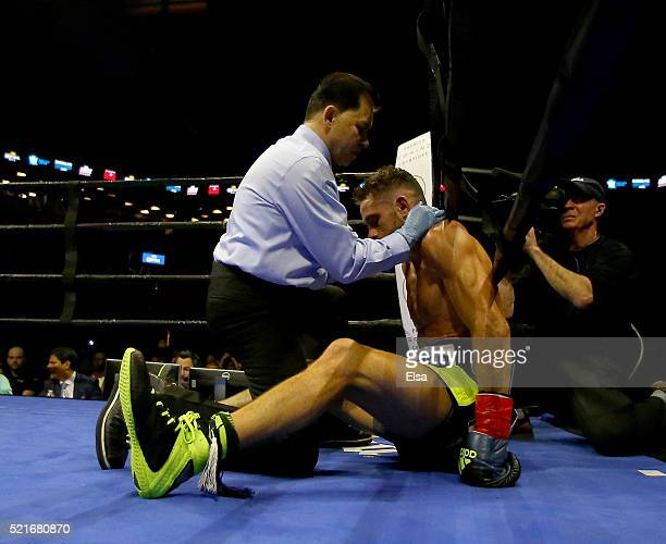 Referee Benjy Esteves stops the fight between Errol Spence Jr and Chris Algieri as he tends to Algieri in the fifth round during their welterwieght...