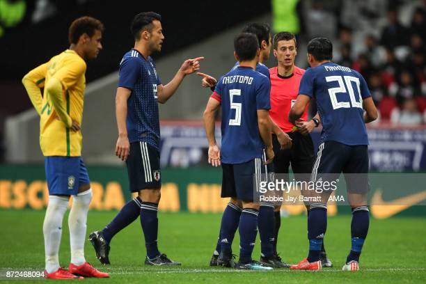 Referee Benoit Bastien awards a penalty to Brazil after using the VAR system during the international friendly match between Brazil and Japan at...