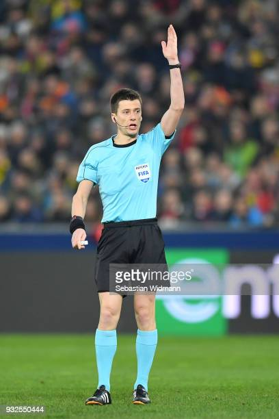 Referee Benoit Bastien gestures during the UEFA Europa League Round of 16 2nd leg match between FC Red Bull Salzburg and Borussia Dortmund at the Red...
