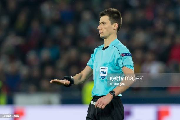 Referee Benoit Bastien gestures during UEFA Europa League Round of 16 second leg match between FC Red Bull Salzburg and Borussia Dortmund at the Red...