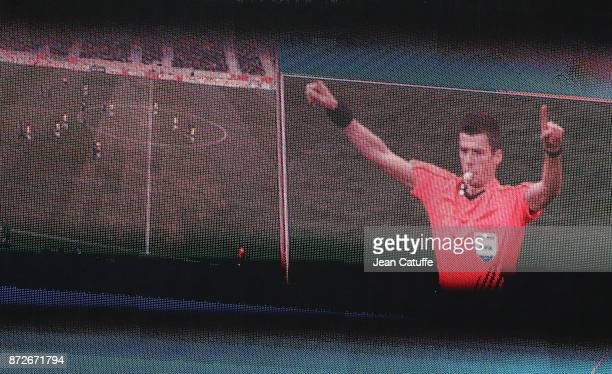 Referee Benoit Bastien of France is using the video during the international friendly match between Japan and Brazil at Stade Pierre Mauroy on...