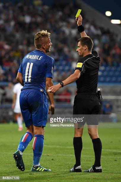 Referee Benoit Bastien show yellow card to Ciro Immobile during the FIFA 2018 World Cup Qualifier between Italy and Israel at Mapei Stadium Citta'...