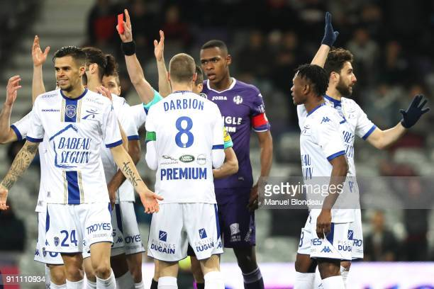 referee Benoit Bastien shows a red card to Jimmy Giraudon of Troyes during the Ligue 1 match between Toulouse and Troyes at Stadium Municipal on...