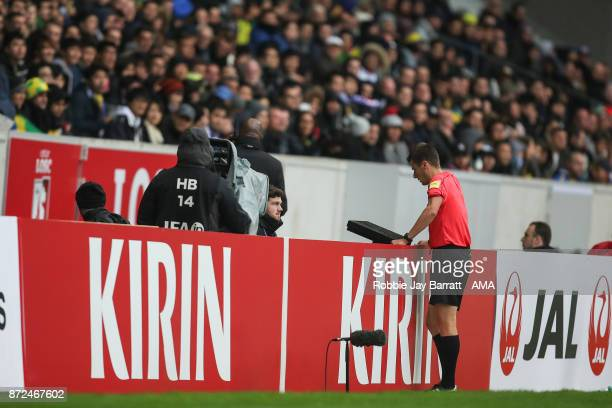 Referee Benoit Bastien uses the VaR system during the international friendly match between Brazil and Japan at Stade PierreMauroy on November 10 2017...