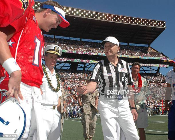 NFL referee Bernie Kukar and U S Navy admiral Tom Fargo set for the coin toss Indianapolis Colts quarterback Peyton Manning at the 2005 Pro Bowl game...