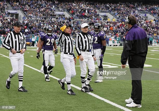 Referee Bernie Kukar Back Judge Steve Freeman and Field Judge Scott Steenson head to the sidelines to discuss a call with head coach Brian Billick of...