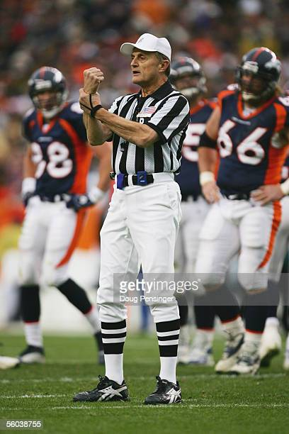 Referee Bernie Kukar calls a holding penalty during the Philadelphia Eagles game against the Denver Broncos at INVESCO Field at Mile High on October...