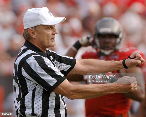 NFL referee Bernie Kukar calls a penalty as the Tampa Bay Buccaneers host the Chicago Bears November 27 2005 in Tampa The Bears defeated the Bucs 13...