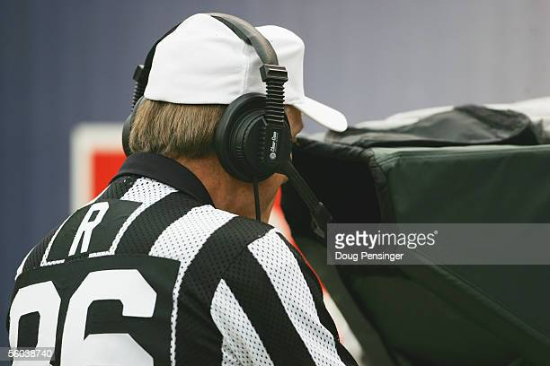 Referee Bernie Kukar looks at a play in the replay booth during the Philadelphia Eagles game against the Denver Broncos at INVESCO Field at Mile High...