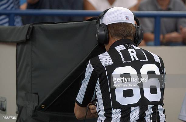 Referee Bernie Kukar reviews a play during the game between the Jacksonville Jaguars and the Indianapolis Colts at the RCA Dome on September 21 2003...