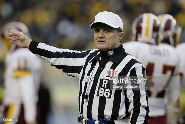 NFL referee Bernie Kukar signals a penalty during a game between the Pittsburgh Steelers and the Washington Redskins at Heinz Field on November 28...