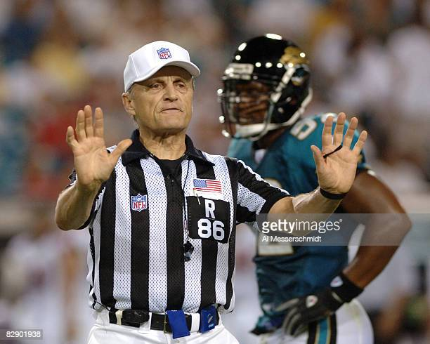 NFL referee Bernie Kukar signals a penalty in a preseason game August 25 2005 in Jacksonville