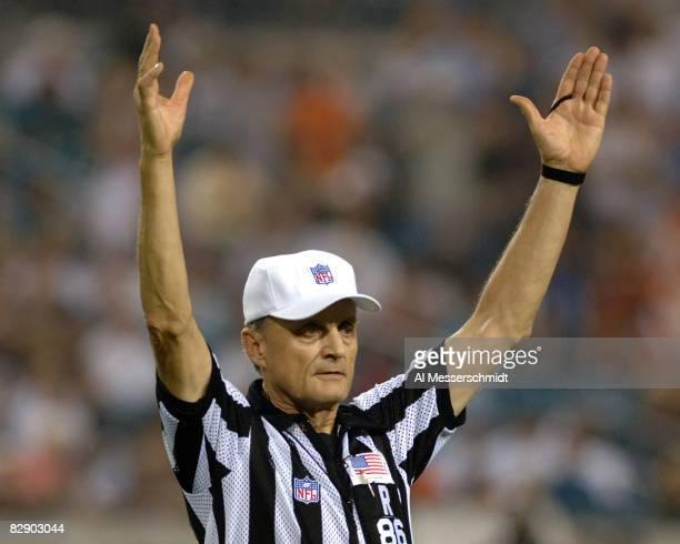 NFL referee Bernie Kukar signals a touchdown as the Cincinnati Bengals play the Jacksonville Jaguars at Alltel Stadium October 9 in Jacksonville The...