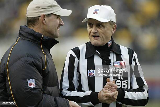 Referee Bernie Kukar talks with head coach Bill Cowher of the Pittsburgh Steelers during a game against the Cincinnati Bengals at Heinz Field on...