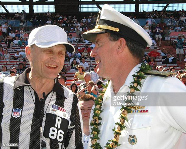 NFL referee Bernie Kukar talks with U S Navy admiral Tom Fargo before the coin toss at the 2005 Pro Bowl game at Aloha Stadium Honolulu February 13...