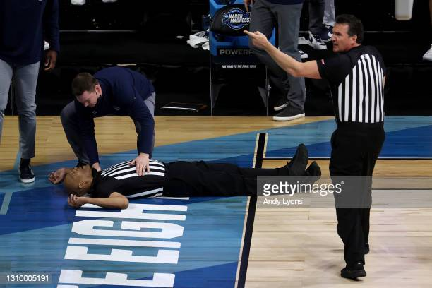 Referee Bert Smith lies on the court after collapsing during the first half of the Elite Eight round game between the USC Trojans and the Gonzaga...