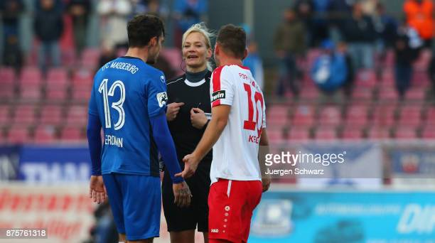 Referee Bibiana Neuhaus gives instructions to Dennis Erdmann of Magdeburg and Maik Kegel of Cologne during the 3 Liga match between SC Fortuna Koeln...