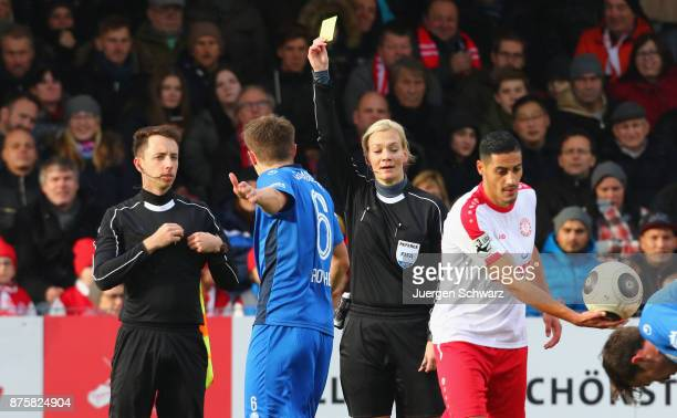 Referee Bibiana Steinhaus displayes Yellow Card for Bjoern Rother of Magdeburg during the 3 Liga match between SC Fortuna Koeln and 1 FC Magdeburg at...