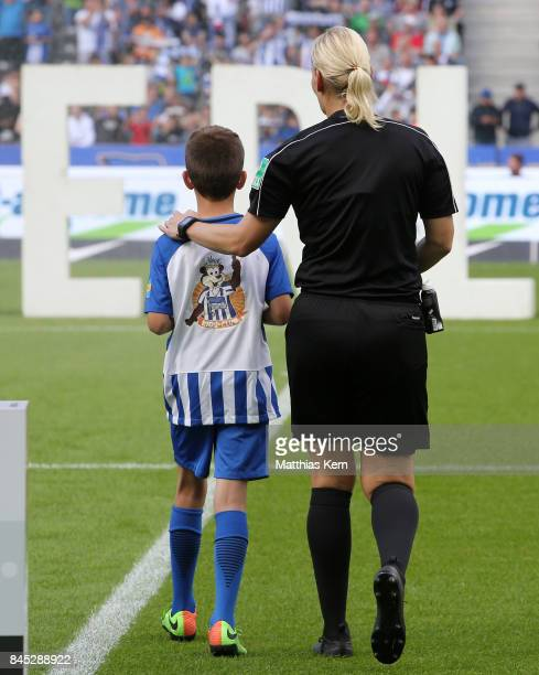 Referee Bibiana Steinhaus enters the pitch prior to the Bundesliga match between Hertha BSC and SV Werder Bremen at Olympiastadion on September 10...