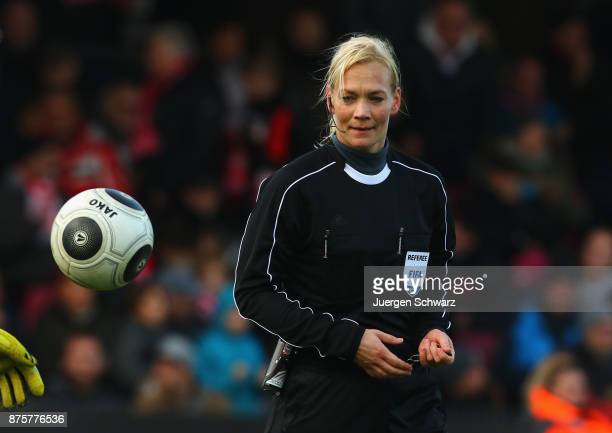 Referee Bibiana Steinhaus eyes the ball during the 3 Liga match between SC Fortuna Koeln and 1 FC Magdeburg at Suedstadion on November 18 2017 in...
