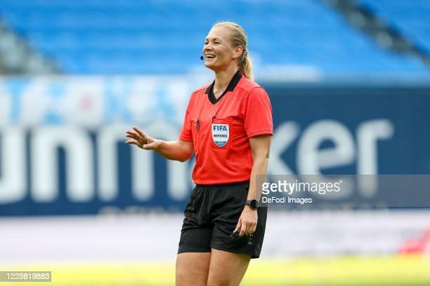 Referee Bibiana Steinhaus gestures during the 3. Liga match between Hansa Rostock and KFC Uerdingen at Ostseestadion on July 1, 2020 in Rostock,...