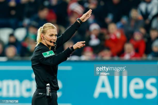 Referee Bibiana Steinhaus gestures during the Bundesliga match between FC Augsburg and FC Bayern Muenchen at WWKArena on February 15 2019 in Augsburg...