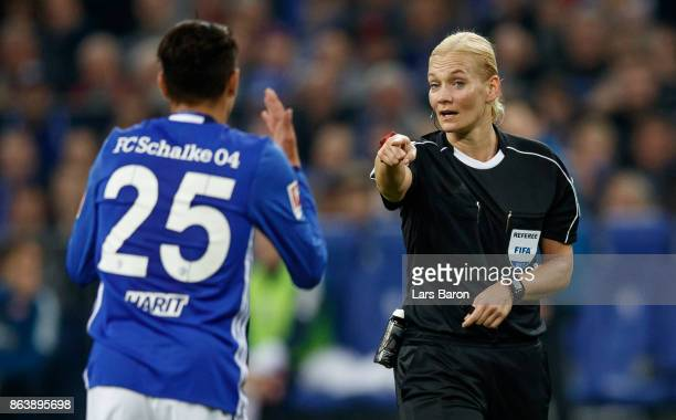 Referee Bibiana Steinhaus gives instructions to Amine Harit of Schalke during the Bundesliga match between FC Schalke 04 and 1 FSV Mainz 05 at...