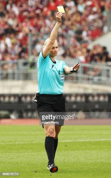 Referee Bibiana Steinhaus gives out a yellow card during the Second Bundesliga match between 1 FC Nuernberg and Fortuna Duesseldorf at...