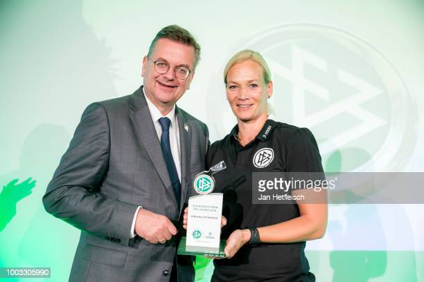 Referee Bibiana Steinhaus is awarded as referee of the year 2018 by Reinhard Grindel head of the DFB during the awarding ceremony on July 21 2018 in...