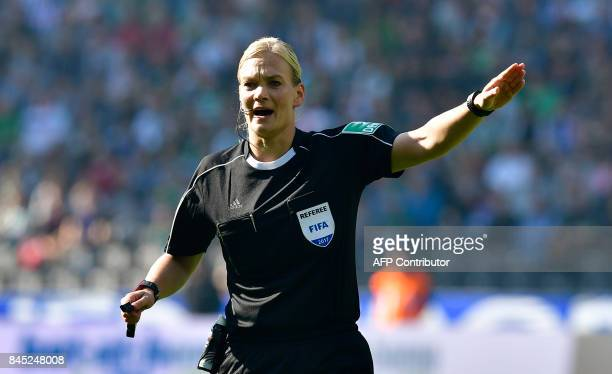 TOPSHOT Referee Bibiana Steinhaus is pictured during the German first division Bundesliga football match between Hertha Berlin and Werder Bremen on...