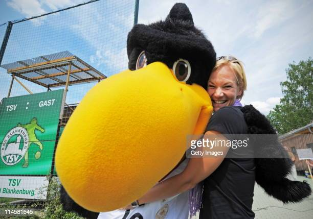 Referee Bibiana Steinhaus jokes with DFB mascot 'Paule' during the DFB Pupils Football Cup at the Landessportschule on May 24 2011 in Bad Blankenburg...