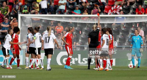Referee Bibiana Steinhaus of Germany shows the red card to Rahel Kiwic of Switzerland during the Group C match between Austria and Switzerland during...