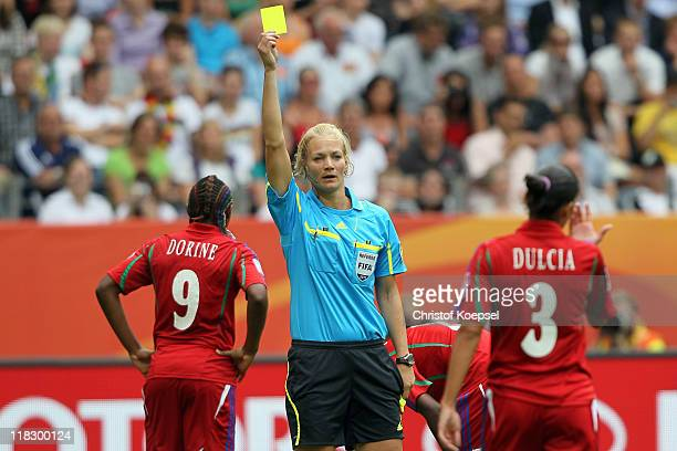 Referee Bibiana Steinhaus of Germany shows the yellow card to Dulcia of Equatorial Guinea during the FIFA Women's World Cup 2011 Group D match...