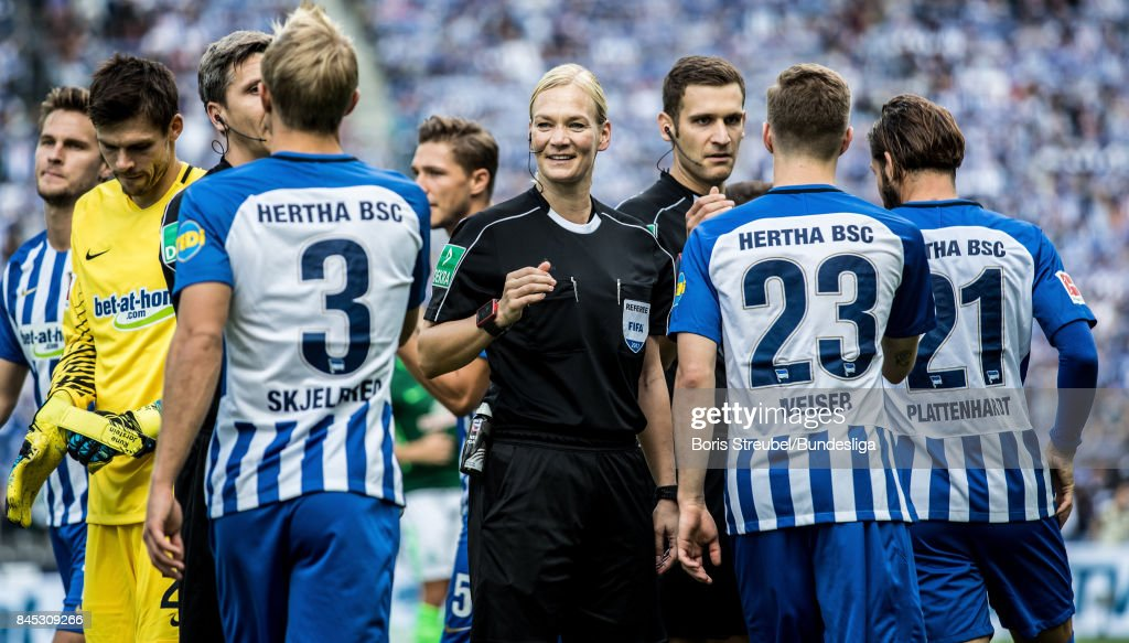 Referee Bibiana Steinhaus shake hands with players of Hertha BSC prior to the Bundesliga match between Hertha BSC and SV Werder Bremen at Olympiastadion on September 10, 2017 in Berlin, Germany.