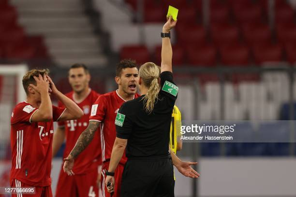 Referee Bibiana Steinhaus shows Lucas Hernandez of FC Bayern München the yellow card during the Supercup 2020 match between FC Bayern Muenchen and...
