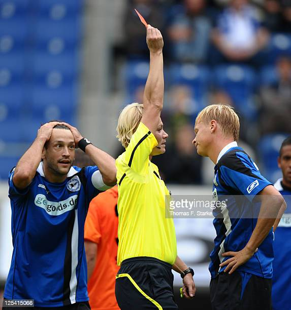 Referee Bibiana Steinhaus shows the red card to Manuel Hornig of Bielefeld while Markus Schuler of Bielefeld reacts during the Third League match...