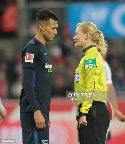 Referee Bibiana Steinhaus speak with Davie Selke of Hertha BSC Berlin during the Bundesliga match between 1 FC Koeln and Hertha BSC at...