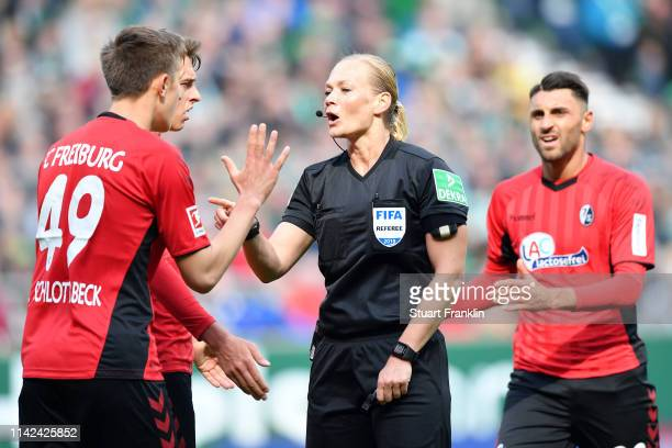 Referee Bibiana Steinhaus speaks with Nico Schlotterbeck of Freiburg during the Bundesliga match between SV Werder Bremen and SportClub Freiburg at...