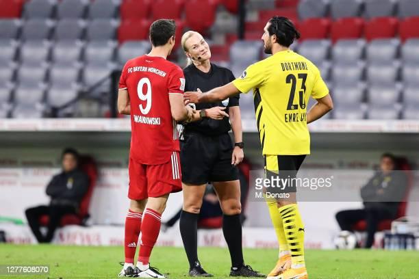 Referee Bibiana Steinhaus speaks with Robert Lewandowski of FC Bayern Muenchen and Emre Can of Borussia Dortmund during the Supercup 2020 match...