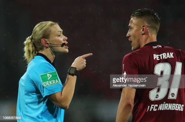 Referee Bibiana Steinhaus talks to Ondrej Petrak of Nuernberg during the Bundesliga match between 1 FC Nuernberg and Bayer 04 Leverkusen at...
