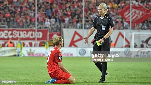 Referee Bibiana Steinhaus talks to Rene Lange of Zwickau during the Third League match between FSV Zwickau and 1 FC Magdeburg at Stadion Zwickau on...