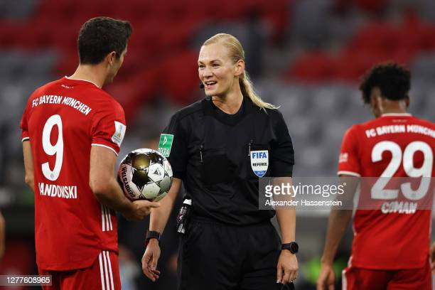 Referee Bibiana Steinhaus talks to Robert Lewandowski of FC Bayern Munich during the Supercup 2020 match between FC Bayern Muenchen and Borussia...