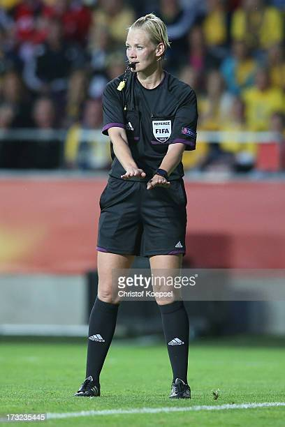 Referee Bibians Steinhaus of Germany gestures during the UEFA Women's EURO 2013 Group A match between Sweden and Denmark at Gamla Ullevi Stadium on...