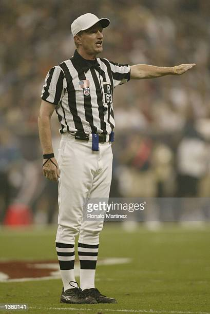 Referee Bill Carollo calls a penalty during the NFL game between the Dallas Cowboys and the Houston Texans on September 8 2002 at Reliant Stadium in...