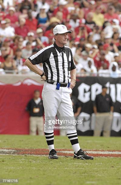 NFL referee Bill Carollo checks play as the Tampa Bay Buccaneers host the St Louis Rams at Raymond James Stadium on September 23 2007 in Tampa...