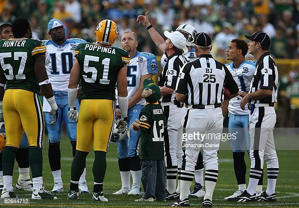 Referee Bill Carollo flips a coin before a game between the Green Bay Packers and the Tenessee Titans on August 28 2008 at Lambeau Field in Green Bay...