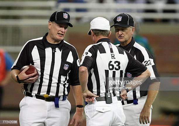 Referee Bill Carollo listens to call during the game between the Detroit Lions and the Chicago Bears on September 30 2007 at Ford Field in Detroit...