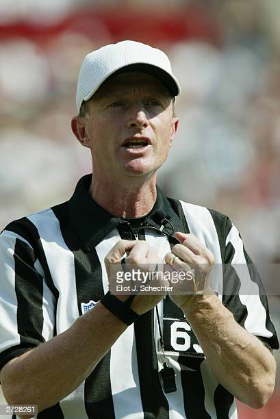 Referee Bill Carollo makes a call in the game between the Tampa Bay Buccaneers and the Dallas Cowboys at Raymond James Stadium on October 26 2003 in...