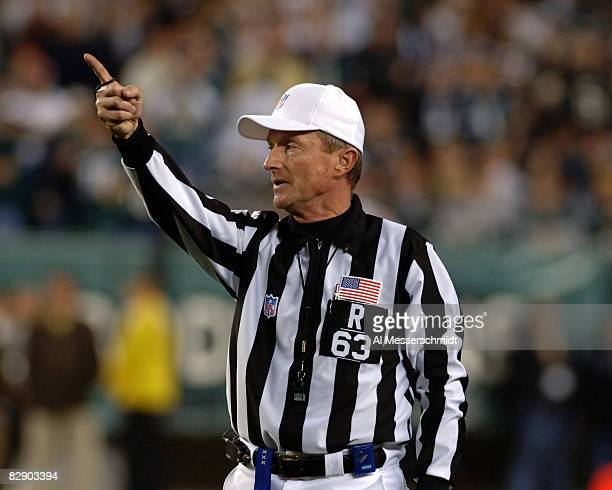 NFL referee Bill Carollo signals a first down as the Dallas Cowboys play against the Philadelphia Eagles November 14 2005 at Lincoln Financial Field...