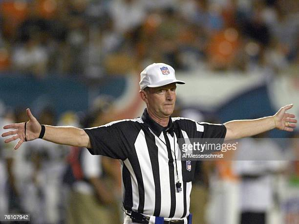 NFL referee Bill Carollo stops play as the Miami Dolphins host the Jacksonville Jaguars at Dolphin Stadium on August 11 2007 in Miami Florida